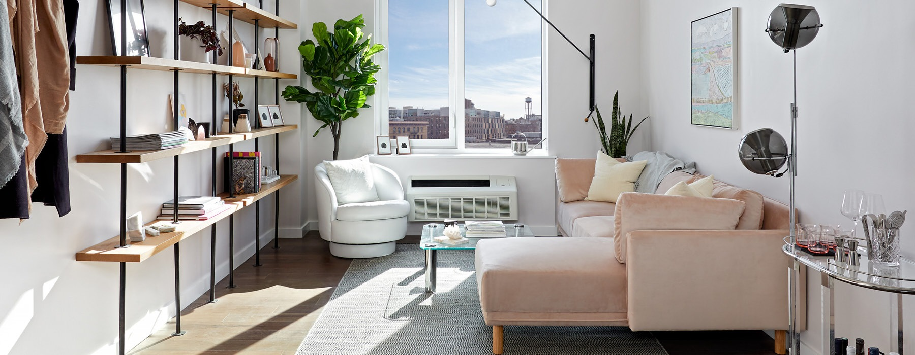 well lit living room with large windows
